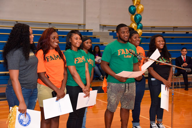 Parramore Kidz Zone youth celebrate their decision to go to college at a local PKZ event. Photo credit: City of Orlando.
