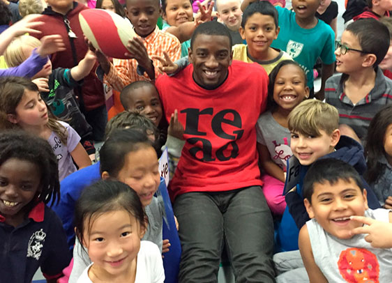 Malcolm Mitchell with children