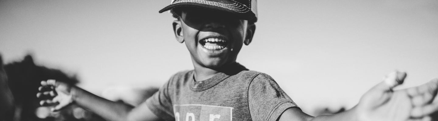 Smiling child in baseball hat
