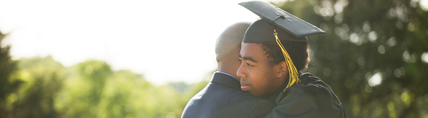 Grad embracing father